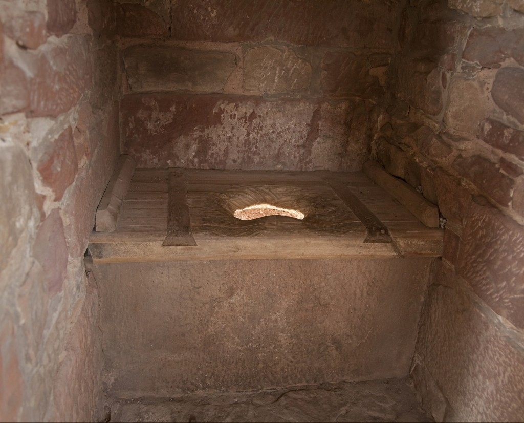 """""""medieval toilet, light is shining through from the dungheap"""""""