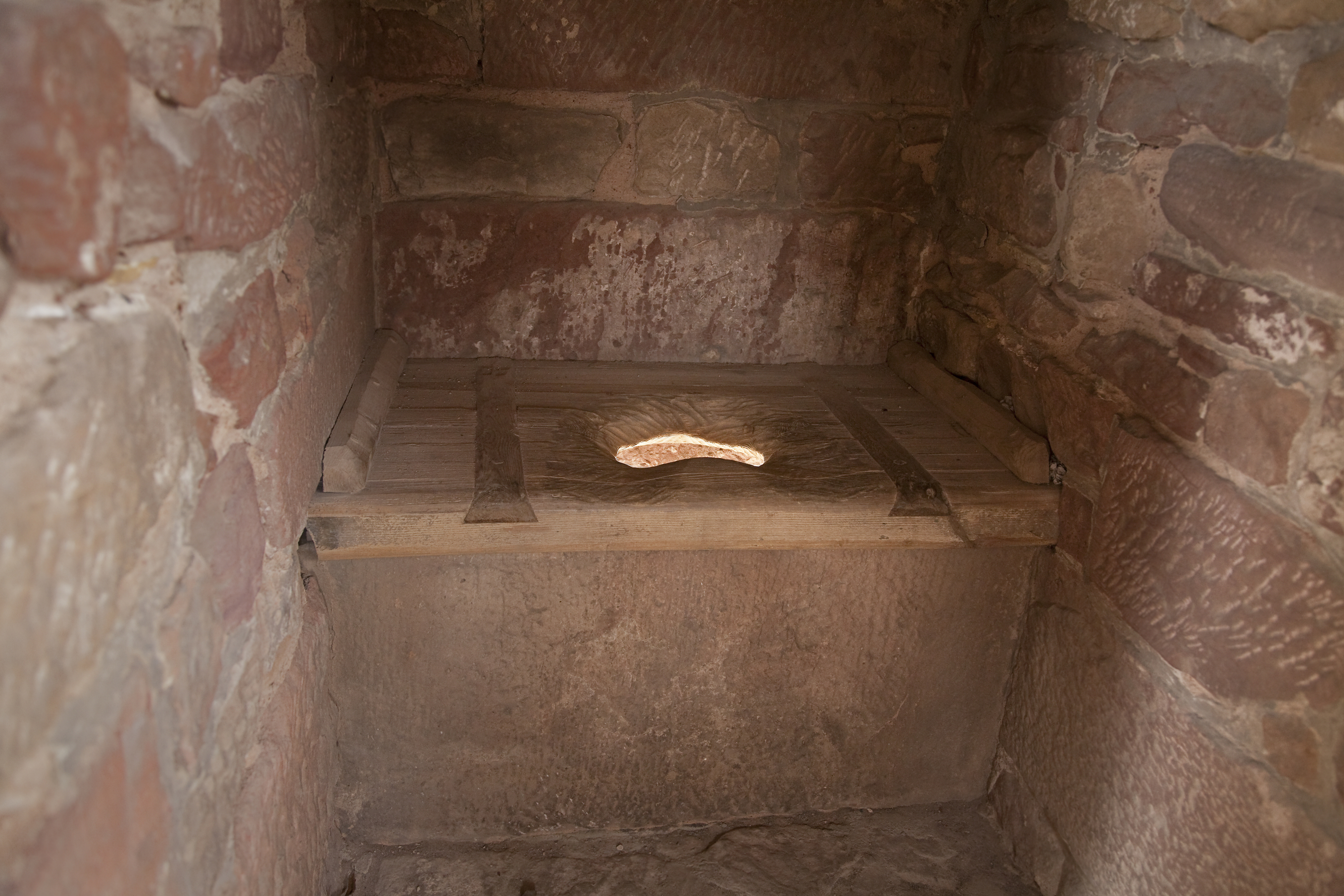 Medieval Toilet Light Is Shining Through From The Dungheap