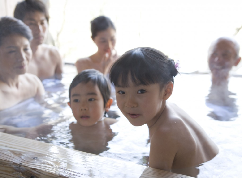 Three-generation family in hot spring